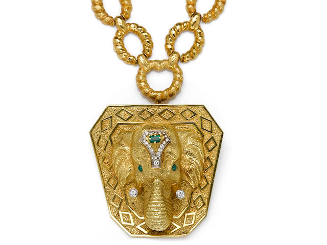 A diamond and emerald elephant pendant/brooch, La Triomphe, with neckchain