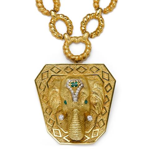 A diamond and emerald elephant pendant/brooch, La Triomphe, with neckchain