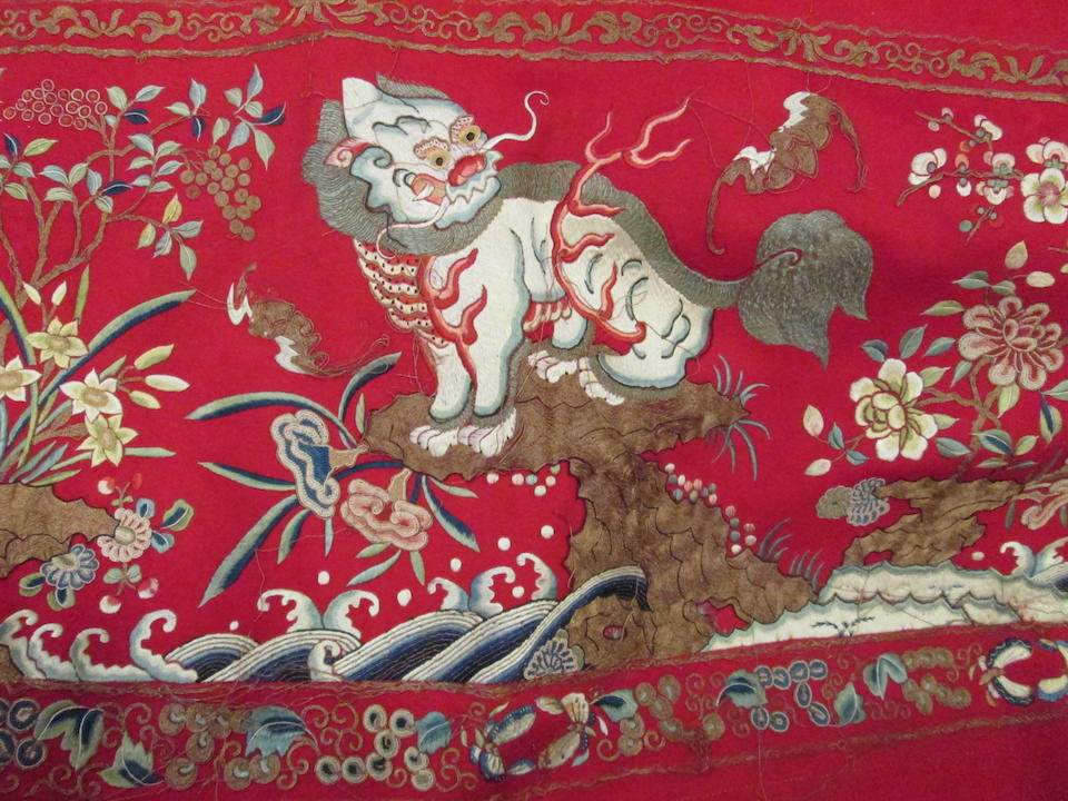 A massive polychrome and gilt embroidered red wool hanging panel Qing dynasty