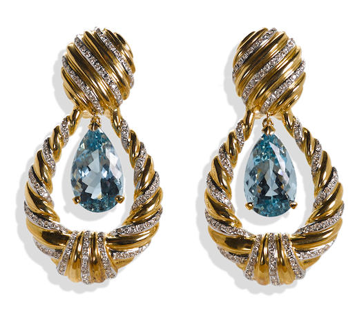 A pair of aquamarine and diamond doorknocker earrings