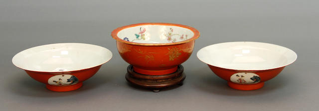 A group of three Chinese iron red and famille rose enameled bowls