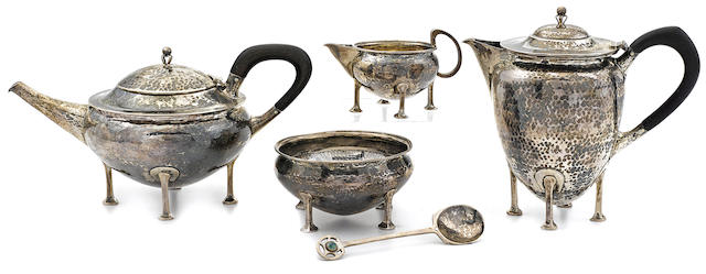 An Edward VII sterling silver Arts & Crafts five-piece tea service by Albert Edward Jones, Birmingham,  1904-10