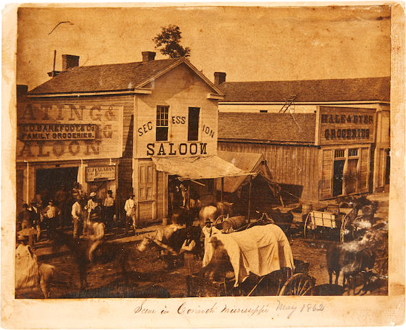 CORINTH, MISSISSIPPI IN 1862. Albumen print photograph, 6 15/16 x 8 15/16 inches, mounted on cardstock, Corinth, Mississippi, 1862, being a street scene,