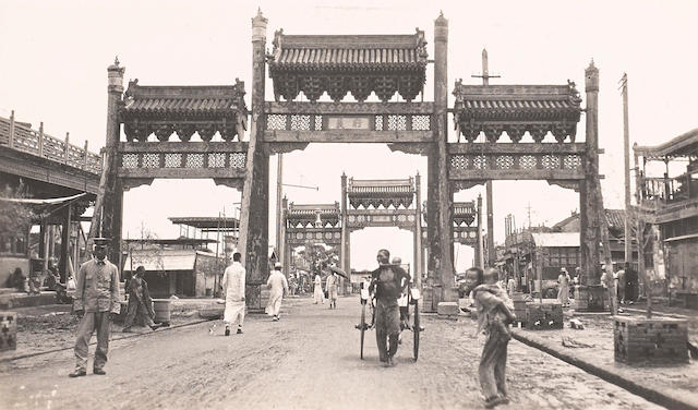 BEIJING—STREET SCENES. Group of 14 silver print photographs, 3 1/4 by 5 1/2 inches through 3 by 4 inches, [Beijing, 1910-1929],