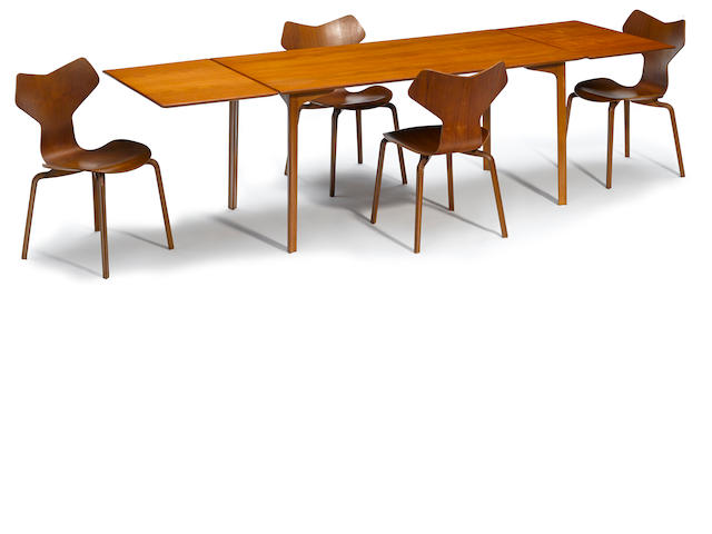 An Arne Jacobsen for Fritz Hansen teak and beech Grand Prix extending dining table and four chairs designed 1957