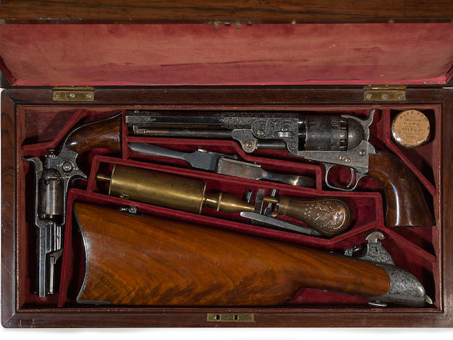 A cased presentation set of Gustave Young engraved Colt percussion revolvers