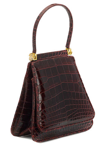 A Judith Leiber red crocodile handbag
