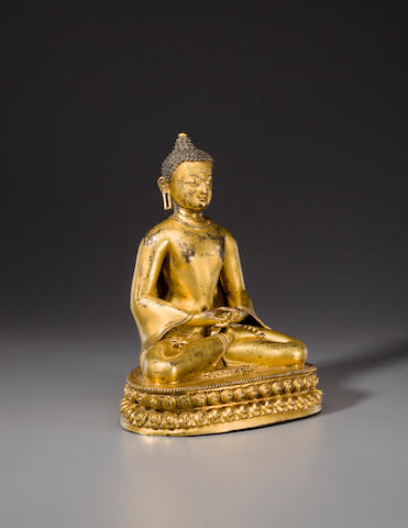 A gilt copper alloy figure of Buddha Tibet, probably Densatil, early 15th century