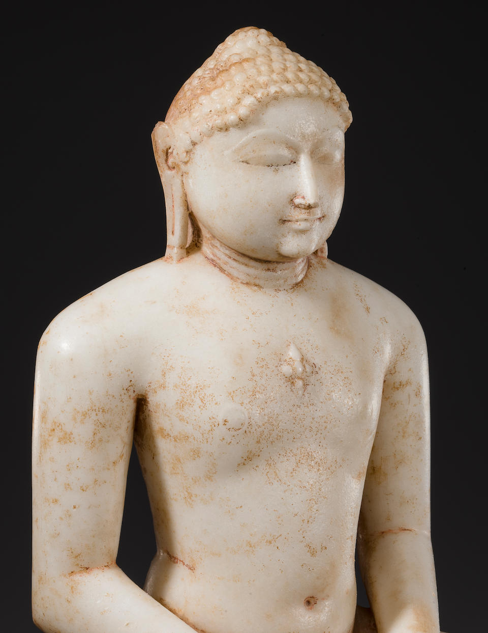 A marble figure of a Jina Gujarat or Rajasthan, circa 11th century