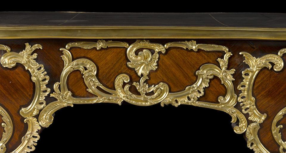 A fine Louis XV style gilt bronze mounted kingwood and mahogany bureau plat after Charles CressentFrançois Linke or Antoine Kriegerlate 19th century