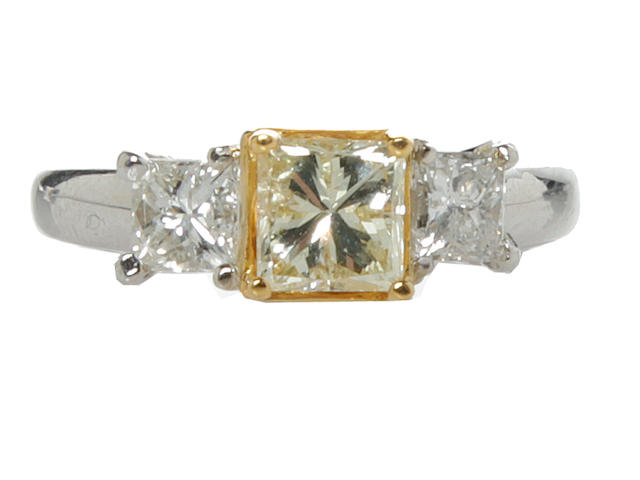 A natural yellow diamond and diamond ring