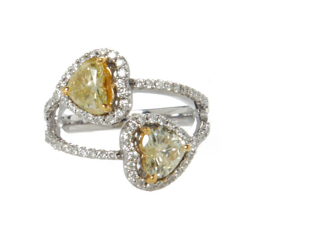 A natural yellow diamond, diamond and 14k white gold heart motif ring