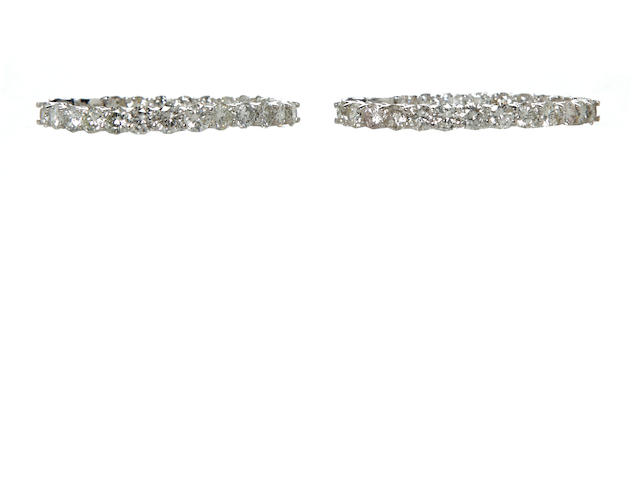 A pair of diamond and 14k white gold hoop earrings