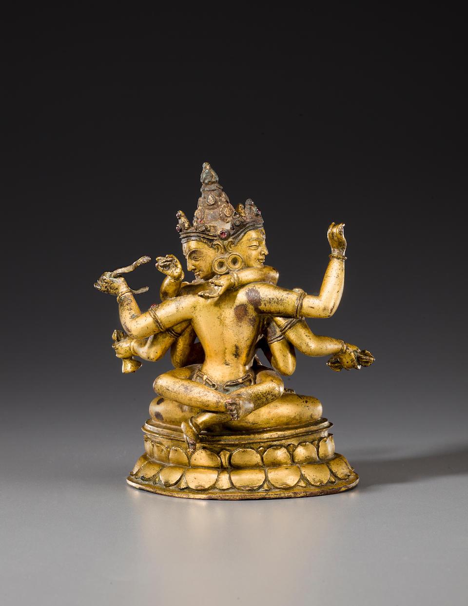 A gilt copper figure of Yogambara  Nepal, circa 13th century