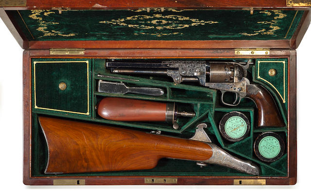 An engraved Colt Model 1851 Navy percussion revolver with shoulder stock in deluxe casing