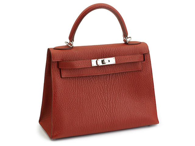 An Hermès red leather Kelly handbag