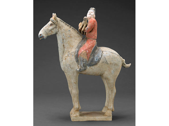 A painted pottery tomb figure of a horseman Tang dynasty