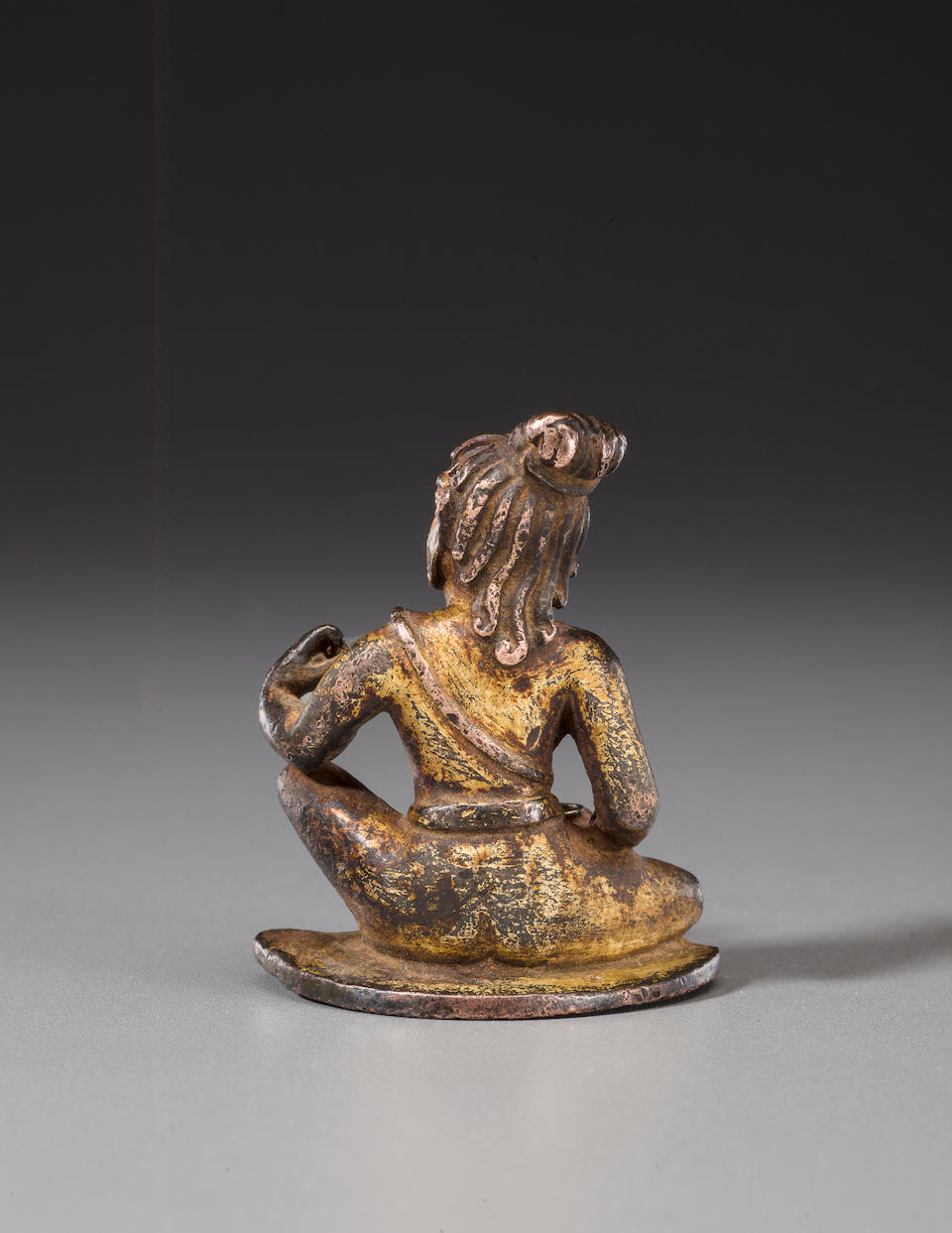A gilt copper figure of a mahasiddha Nepal or Tibet, circa 12th century