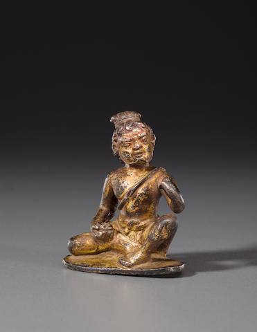 A gilt copper figure of a mahasiddha Nepal or Tibet, circa 12th century