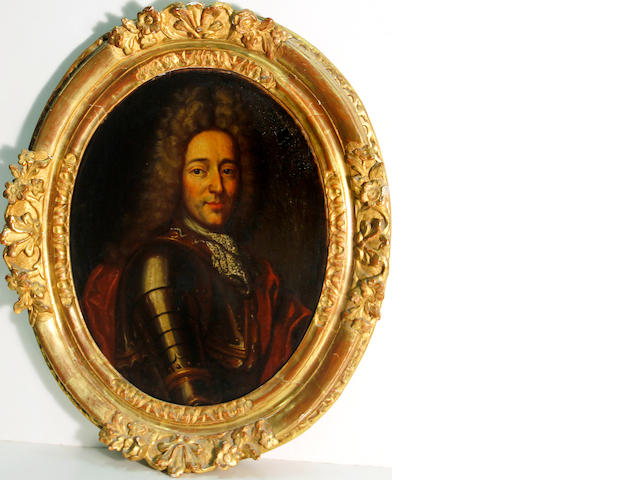 French School, 18th Century A portait of a nobleman, wearing armour, bust-length oval, 16 1/4 x 13in