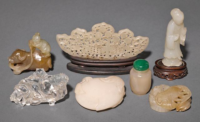A group of seven small carved hardstone decorations