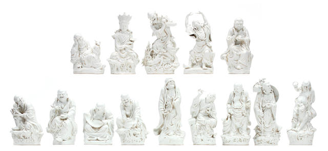 A group of eighteen Chinese glazed earthenware figures of Lohans