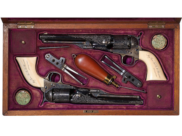 A cased and factory engraved pair of Colt Model 1861 Navy percussion presentation revolvers