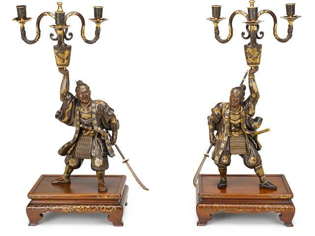 An impressive pair of Miyao bronze candelabra By the Miyao workshop, Meiji period (late 19th century)