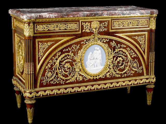 A fine Louis XVI style gilt bronze and porcelain mounted mahogany commode a vantaux after Guillaume BennemanFrançois Linkefourth quarter  19th century