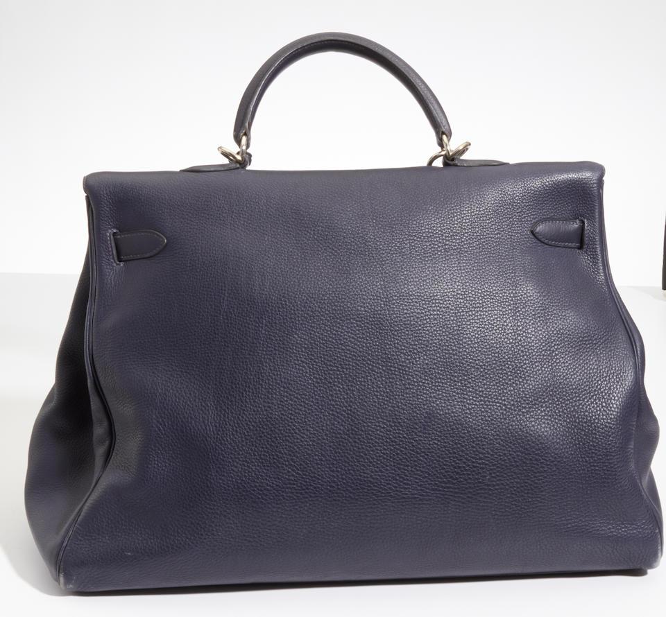 An Hermès blue leather Travel Kelly handbag