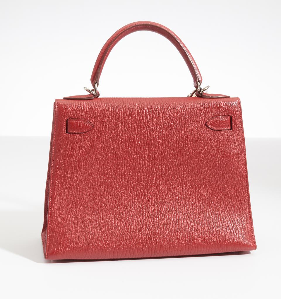 An Hermès red leather Kelly handbag