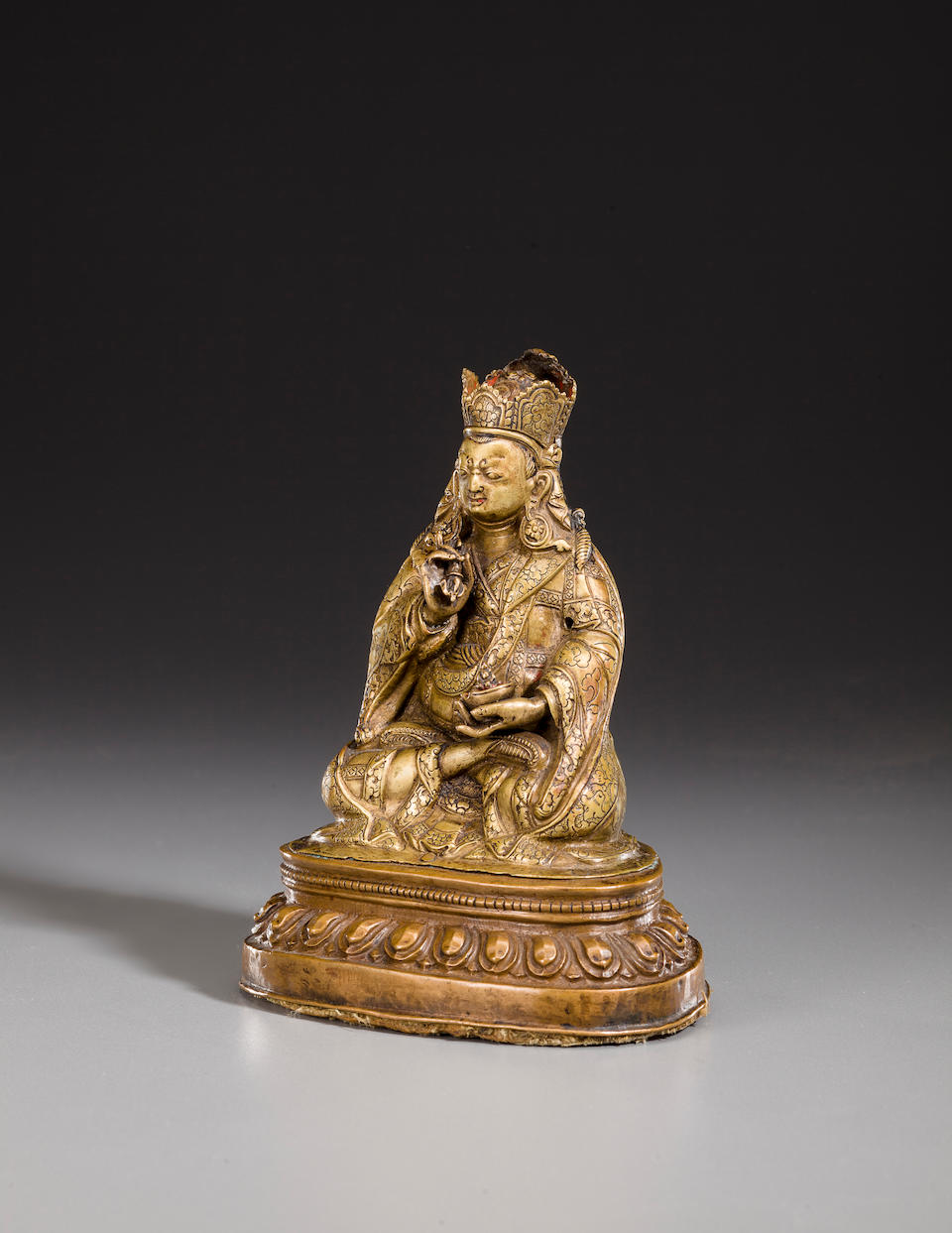 A copper and copper alloy repoussé figure of Padmasambhava  Tibet, 15th century