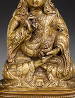 A copper and copper alloy repoussé figure of Padmasambhava  Tibet, 15th century