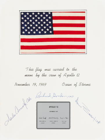 UNITED STATES FLAG CARRIED TO THE MOON ON APOLLO 12. CERTIFICATE SIGNED BY THE ENTIRE APOLLO 12 CREW.