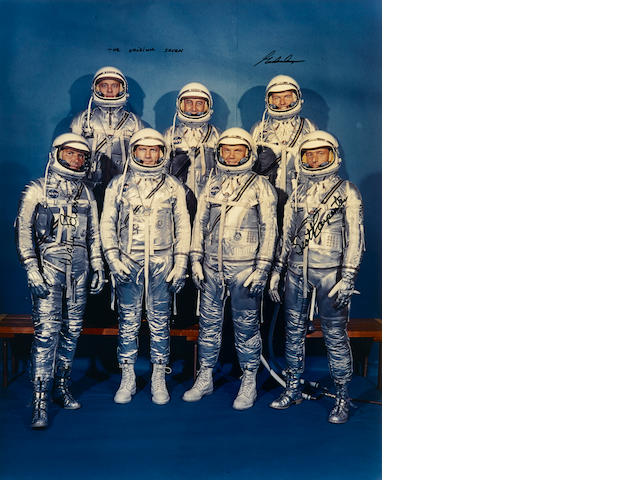 THE ORIGINAL MERCURY SEVEN IN SPACE SUITS—SIGNED.