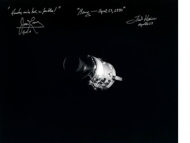 APOLLO 13. SIGNED BY LOVELL AND HAISE.