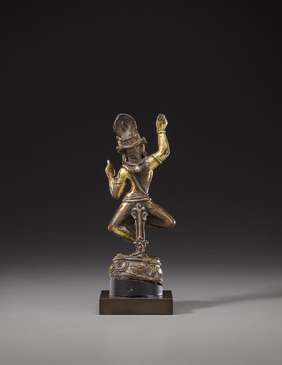 A gilt copper figure of Vajrapani Nepal, circa 10th century