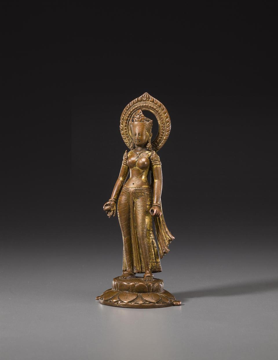 A gilt copper figure of Devi Nepal, circa 10th century