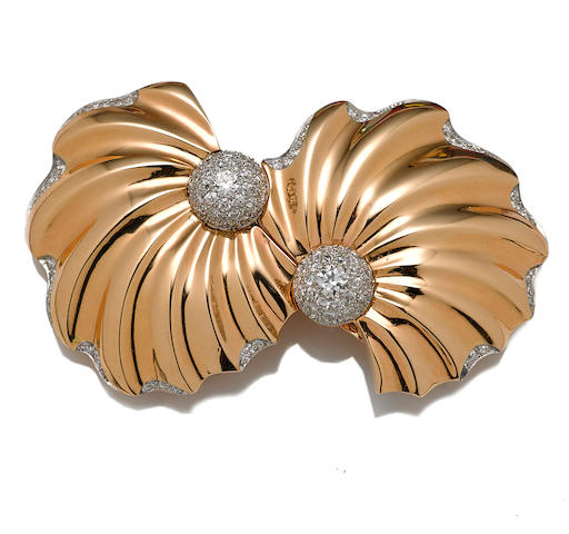 A diamond and fourteen karat gold double-clip brooch