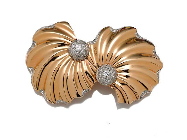 A diamond and fourteen karat gold double-clip brooch