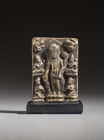 A copper votive tablet of Padmapani Nepal, Licchavi period, 8th century
