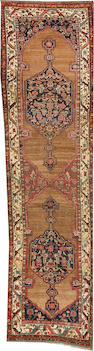 A Kurdish runner   Northwest Persia size approximately 3ft. 7in. x 14ft.