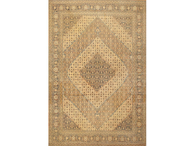 A Hadji Jalili Tabriz carpet  Northwest Persia size approximately 10ft. 3in. x 15ft. 6in.