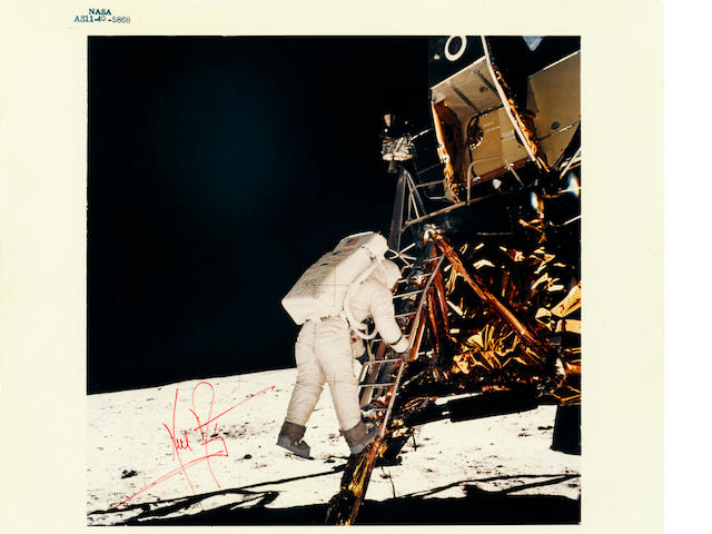 ARMSTRONG STEPS DOWN TO THE MOON.