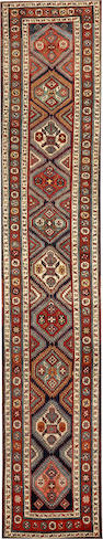 A Heriz runner  Northwest Persia size approximately 3ft. 3in. x 17ft.