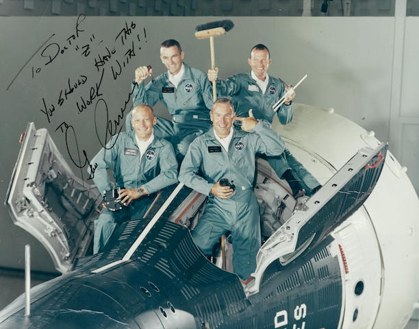 GEMINI 12 CREW HORSING AROUND—SIGNED BY CERNAN.