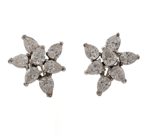 A pair of diamond cluster earrings