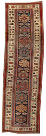 A Kurdish runner  Northwest Persia size approximately 3ft. 9in. x 12ft. 6in.