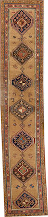 A Kurdish runner  Northwest Persia size approximately 2ft. 7in. x 12ft. 9in.