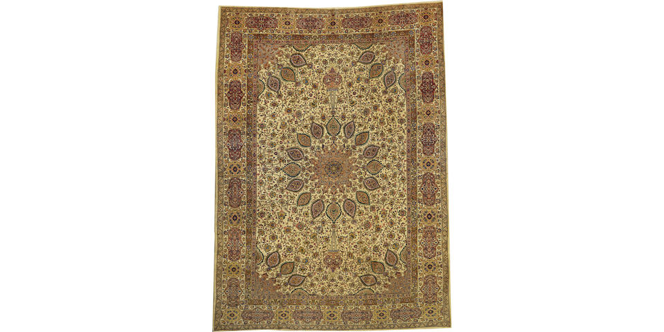 An Indo Sarouk carpet India size approximately 8ft. 6in. x 12ft. 3in.